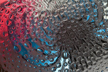 Striped Spheres Rotate In Different Directions Against A Red-gray-blue Background. Abstract Fantasy. 3D Render.