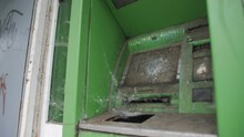 Vandalized And Abandoned ATM Covered In Dirt And Cobwebs In The City.