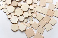 Hexagonal And Square Shapes In Wood Arranged Loosely On A White Background