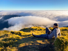 Rear View Of Man Infront Of Sea Of Clouds