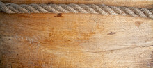 An Old Rough Oak Board And A Nautical Rope On It Forming A Frame With An Empty Space