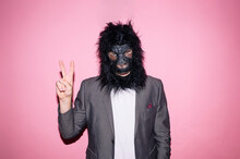 Gesture Man Wearing Gorilla Mask And Making V Sign With Hand