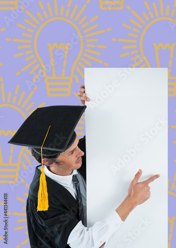 Boy wearing graduation hat and robe holding a blank placard against light bulb concept icons