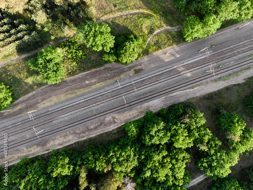 Aerial view of railroad in sunny summer day in forest Fototapet
