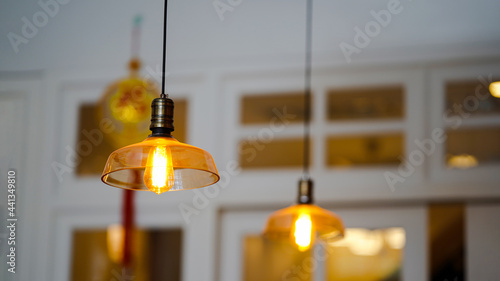 Canvas Modern style lamps hang from the ceiling or ceiling lamps, illuminating in gold