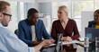 Leinwandbild Motiv Serious african executive listening to employees report looking at tablet screen