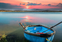 Old Rustic Boat On A Lakeside During Sunset With Langeberg Mountain In The Background