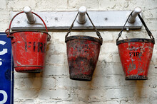 Three Red Fire Buckets In An Workshop In Beamish Village
