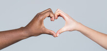Charity, Love And Diversity - Closeup Of Female And Male Hands Of Different Skin Color Making Heart Shape. People Different Skin Colors Put Their Hands Together Making Heart Shape In White Background
