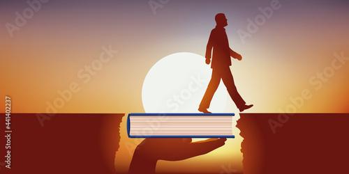 Fotografie, Obraz Importance de la culture et de l'éducation dans la réussite professionnelle, avec un homme qui franchit un obstacle grâce à un livre qui lui sert de pont