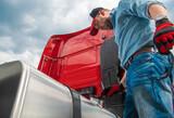 Fototapeta Łazienka - Semi Truck Driver Looking at Diesel Tank Cap