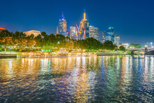 City Lights Of The Melbourne Skyline Reflected In The Yarra River