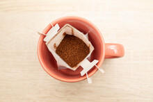 Coffee Drips In Cup. Alternative Brewing Specialty Coffee In Paper Filter Bags.