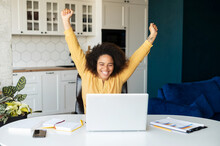 Overjoyed African-American Freelancer Woman Yelling Yes, Looking At The Laptop Screen, Celebrating Victory, Goal Achievement, Black Female With Afro Hairstyle Raised Arms Up, Received Opportunity