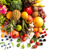 Assortment Of Various Fresh Vegetables And Fruits Stacked In A Pile