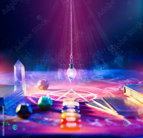 Fototapeta Fortune Teller And Tarot - Pendulum On Altar With Defocused Cards And Chakra Sto