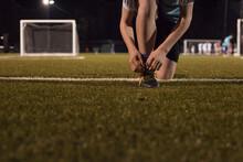 Young Teen Boy Preparing To Do Evening Soccer Training