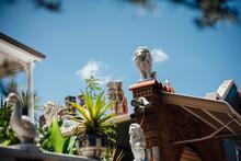 Ceramic Figurines In Front Garden