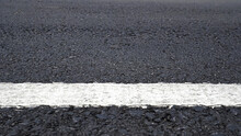 Surface Rough Of Asphalt, Grey With White Line On Grainy Road, Texture Background, Close Up