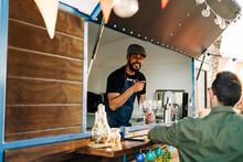 Man Attending Customers In Food Truck