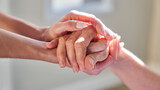 Fototapeta Na sufit - Hands held by senior woman for assistance in hospice