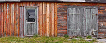 Panorama Image Of A Wooden Wall With Doors Of An Old Dilapidated Barn