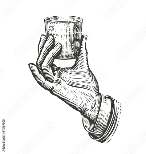 Hand holding a glass. Illustration drawn in vintage engraving style