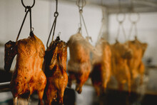 Roast Duck Hanging In Cafe Kitchen