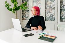 Pensive Fashion Designer Working At Home