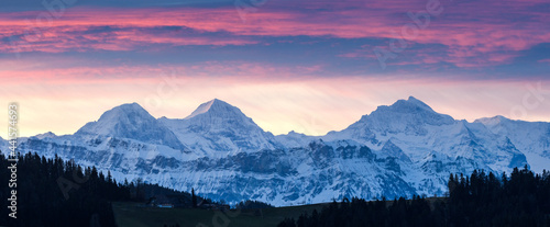 Fotografie, Obraz Eiger Mönch and Jungfrau at sunrise on a winter morning