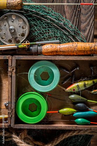 Fototapeta Handmade fishing equipment with flies and rods