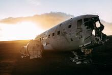 Broken Airplane Between Wild Lands In Sunny Day