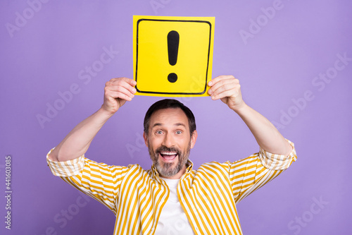 Fototapeta Photo of cute impressed age gentleman wear striped shirt holding exclamation poi