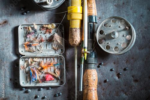 Fotografie, Obraz Handmade fishing equipment with flies and rods
