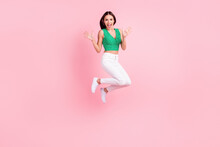 Full Length Body Size Photo Woman In Casual Outfit Smiling Jumping High Amazed Isolated Pastel Pink Color Background