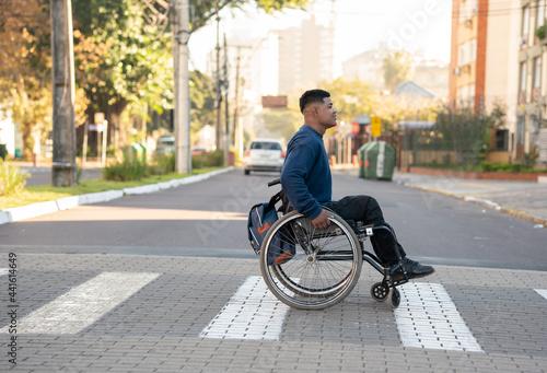 Fényképezés profile of black man with wheelchair crossing the street.