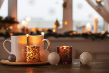 Two White Cups With Christmas Decorations On Background Window