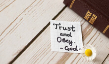 Trust And Obey God And Jesus Christ. Biblical Concept About Complete Faith, Hope Belief In God's Word, Holy Bible. Blessings From Obedience.