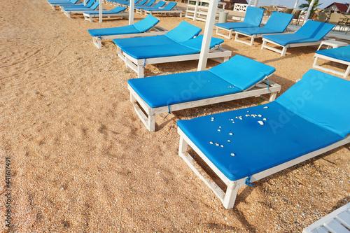 Obraz na plátne Empty sun loungers on the beach.