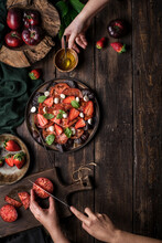 People Preparing A Healthy Tomato And Strawberry Salad
