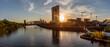 Europäische Zentralbank in Frankfurt am Main mit Skyline im Sonnenuntergang