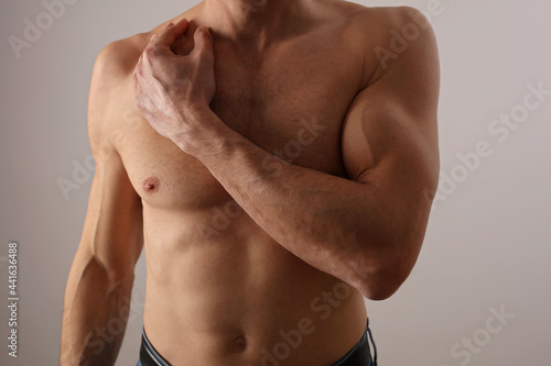 Fotografie, Obraz Stronge Muscular male body, biceps muscles close up