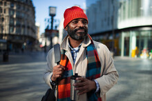 Portrait Handsome Businessman In Stocking Cap With Coffee In City