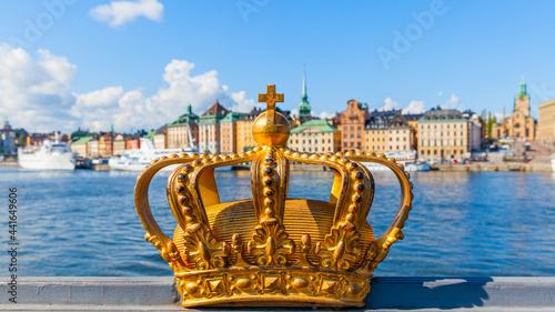Photo Golden crown on Skeppsholm bridge in Stockholm