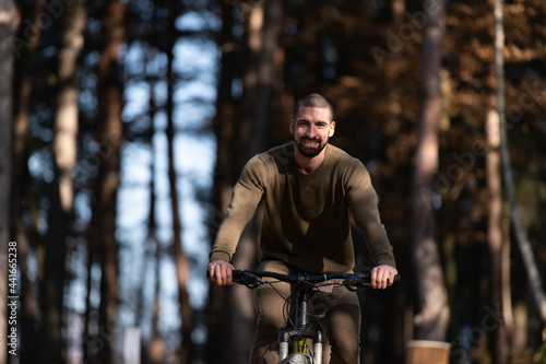 Fotografija Man Riding a Bicycle in Nature