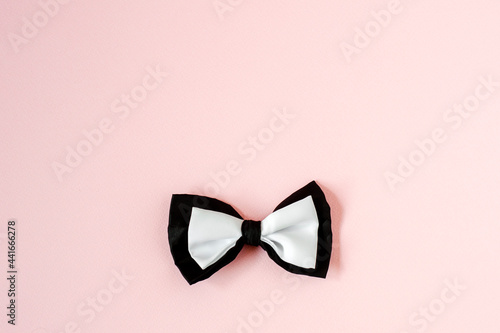 Tablou Canvas Black and white bow tie on a pastel pink Copy space background.