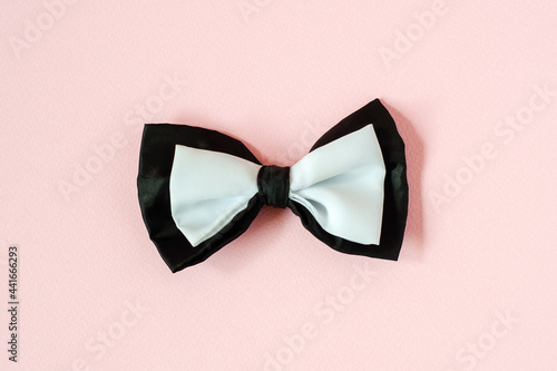 Foto Black and white bow tie on a pastel pink Copy space background.