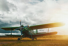 Vintage Aircraft Preparing For Take-off On The Background Of Stormy Sky
