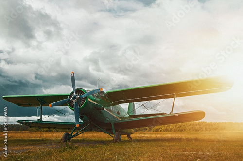 Canvas Print Vintage aircraft preparing for take-off on the background of stormy sky