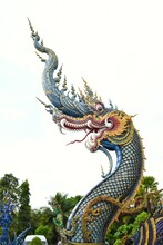 King Of Nagas Of Chiang Rai Blue Temple Or Wat Rong Seua Ten, Thai Folklore And Streaks Of Metallic Gold, All Contributing To The Temple's Magnificence.